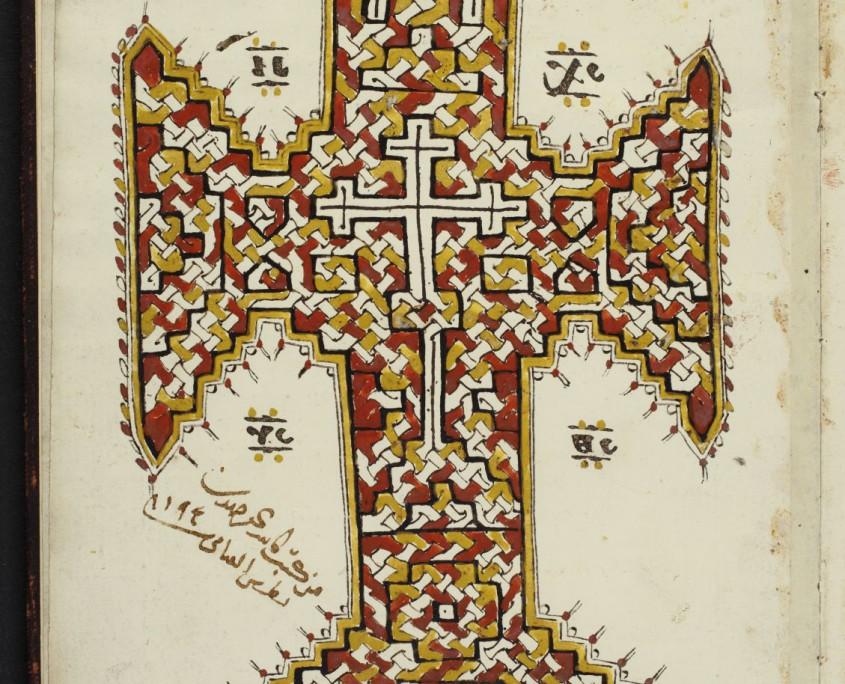 Buchschmuck in Form eines Kreuzes